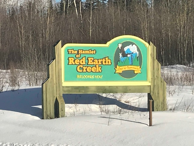 The Red Earth Creek sign
